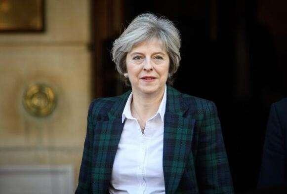 英国首相梅:6月8日举行提前大选